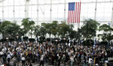 People stand in lines before the main security check point at Denver International Airport on...