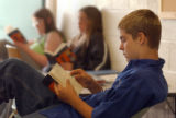 (Denver, Colo., August 26, 2004) Student Craig Montgomery, 14, of Thornton reads in class during...
