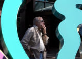 Robert Ellison (cq) watches  his 14-foot-tall abstract sculpture as it is raised by crain in front...