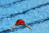 DLM0328  Christian Madrid, 11, dives into the Congress Park Pool Monday, June 4, 2007. Christian...