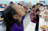 Adrianna Sanchez,7 finishes off her milk during  lunch at Castro Elementary School Monday May 4,...