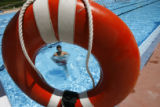 DLM0392  Christian Madrid, 11, comes up for air at the Congress Park Pool Monday, June 4, 2007....
