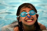 DLM0727  Melissa Rodriguez, 10, is all smiles as she swims at the Harvey Park Pool Monday, June 4,...