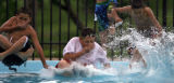 DLM0763  Angelo Benavidez, 10, from left, L.J. Mendez, 11, and Ronnie Garcia, 13, leap into the...