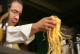1180 Renowned chef Emeril Lagasse prepares Clams, Mussels, Shrimp, and Oysters with Piri Piri...