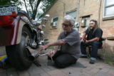Gary Jackson, cq, of Denver  installs a used OEM Harley police motorcycle exhaust on his Fat Boy...