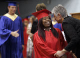 Marshalltown High School Principal Bonnie Lowery (cq)congratulates graduate Amber Kelly, 18, as...