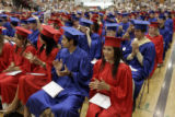 The Marshalltown High School Class of 2007 claps after Principal Bonnie Lowery addressed them...