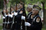Members of the Ceremonial Units for the American Legion Post #46 and the V.F.W Post #839 in...