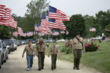 Troop leaders and members of Boy Scout Troop 310 from Marshalltown, Iowa, arrive to the Rose Hill...