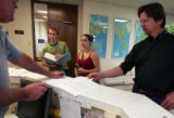H.Ray Priest, left, President of International Passport Visas, puts together  Mitch Jervis' ,...
