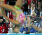 (ATHENS, GREECE-AUGUST 27, 2004)  A judge for synchronised swimming watches closely as Russia...