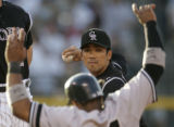 0181 Colorado Rockies Kazo Matsui turns a doubble play by throwing over New York Yankees #24...