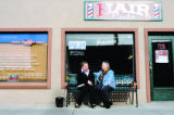 Commece City, City Planner Jessica Osborne, cq, sits on a bench with Urban pioneer Dana Crawford,...