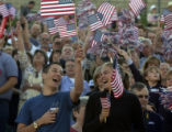 (Greenwood Village, Colo., September 14, 2004)  Michael Pacini  and Heidi Shray waved flags before...