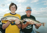 Father and son Kyle, left, and Dick Hoffmeister, of Colorado Springs, worked hard with jigs and...