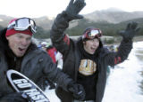 ( L-R) Jeff Meyer (cq) left, and Trailer Tom (cq) cheer as they dash  for the chair lift  as...