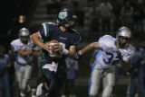 Thunder Ridge's #8 Alex Sawyer makes a pass as Ralston Valley's #32 Lee Marshall at Shea Stadium...