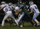 Ralston Valley's #3 Cameron Wright gets sacked by Thunder Ridge's #93 Chris Graziano at Shea...
