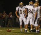 Holy Family's #56 Mike Demmon listens to instruction from the coach  in th 4th quarter at Faith...