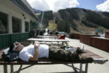 Alex Silber (cq) from Boulder catches some rays at  Abasin as it  opens for business Wednesday...
