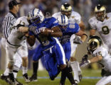 Air Force fullback Jacobe Kendrick (8) in action against Mike Pagnotta (13), Jake Galusha (15) and...
