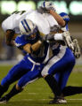 Air Force free safety Bobby Giannini (11) tackles Colorado State wide receiver Johnny Walker in...