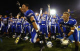 Air Force cornerback Chris Sutton, left, and halfback Chad Hall (1), lead the charge to the fans...