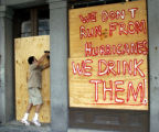 LABH110 - Ngai Smith works to cover the windows of a building in the in the French Quarter of New...