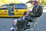 James Robinson (cq), a contract driver for Yellow Cab, helps Karol Ann Jones (cq) from his cab to...