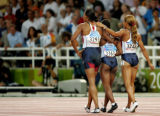 (ATHENS, GREECE-AUGUST 27, 2004) United States' Marion Jones, left,Lauryn Williams,center, and...
