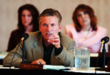 (BOULDER, Colo., May 19, 2004) University of Colorado Regent Jim Martin asks a question of the...