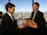 Phoenix, Arizona:  Phoenix Mayor Phil Gordon (L), fulfills a food wager on the outcome of World...