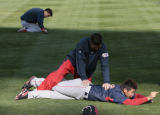 Boston Red Sox starting pitcher for Saturday, Daisuke Matsuzaka, gets worked over by a trainer,...