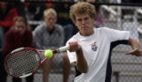 Andy Benson, Cherry Creek, Sr. Will Vasos , Rocky Mountain, Sr.  returns a volley in the 1st set...