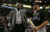 [JPM0048]  Colorado Rockies Jamey Carroll, left, talks to Hall of Famer Frank Robinson, before the...