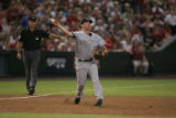 [JPM0245]  Rockies third baseman Garrett Atkins throws out Eric Byrnes in the third inning of the...
