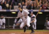 [5332]  Colorado Rockies Kaz Matsui hits a double that Boston Red Sox left fielder misplayed in...