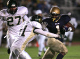 (Denver, Colo., August 27, 2004) Mullen's #1- Maurice Greer, right, runs past Bear Creek defenders...