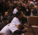 [8022]  Colorado Rockies pitcher Manny Corpas and Yorvit Torrealba, in foreground, watch the ninth...