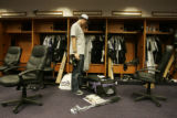 [349} Colorado Rockies Jeff Francis, looks over his belongings in the Rockies Clubhouse after the...
