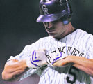 [6450]  Colorado Rockies Matt Holliday tears off his batting glove after popping out to first base...