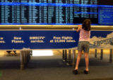 Denver, Colo., photo taken May 19, 2004- Megan Gonzales,11, takes a look at the flight arrivals...