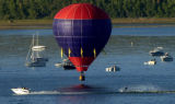 "(LITTLETON Colo., August 29,2004) The pilot of this balloon gets ready to do a ""splash and..."