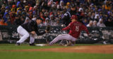 Diamondback Jeff Salazar advances to third base on a Miguel Montero single in the second inning of...