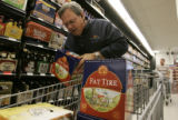 Dave Diels  (cq) from Salt Lake City , stocks up on Fat Tire, a favorite beer of his he can't buy...