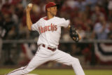 [JPM537] Diamondbacks pitcher Juan Cruz delivers a pitch after coming in the ballgame to relieve...