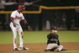 [JPM631]  Colorado Rockies second baseman Kaz Matsui sits on the ground after being interfered...