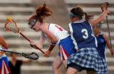(Englewood, Colo., May 19, 2004) Caroline Cryer, #13, left, of Cherry Creek High School, yells as...