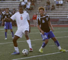 Smoky Hill's #9 Stephen Solano Cargill works the ball with Grandview's #15 Cameron Gorsevski at...